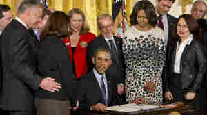 President Barack Obama signs the Clay Hunt Suicide Prevention for American Veterans Act, named for a Marine Corps combat veteran who struggled with post-traumatic stress disorder after serving in Iraq and Afghanistan and who killed himself in March 2011 at the age of 28. The bill calls for evaluation and expansion of existing Veterans Affairs mental health and suicide prevention programs.