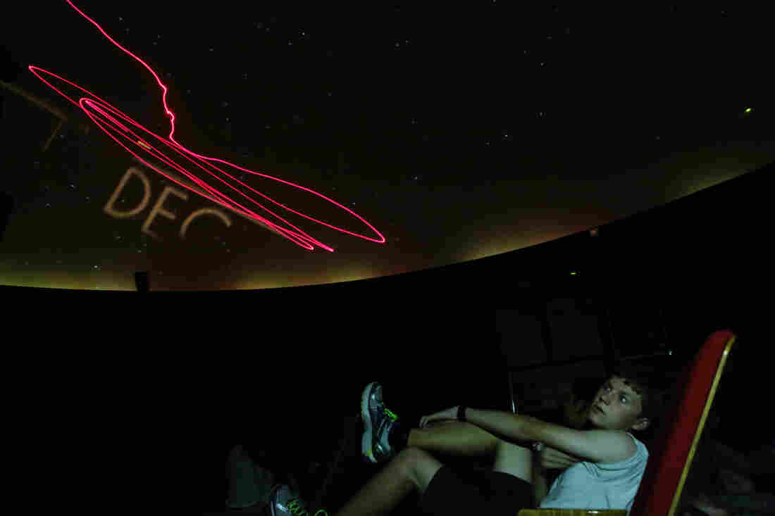 Jasper Barnett, a junior at Thomas Jefferson High School for Science and Technology in Alexandria, Va., looks up in the school's planetarium.