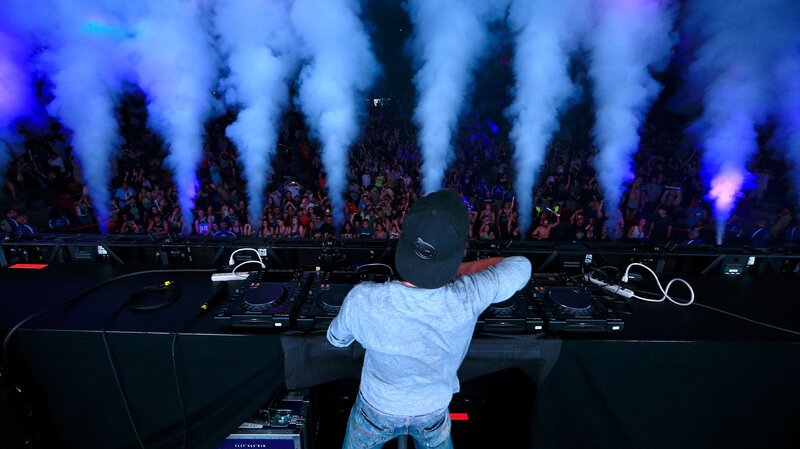 Avicii performs during the KROQ Weenie Roast at Verizon Wireless Music Center on May 31, 2014 in Irvine, California.