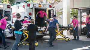 A patient is wheeled into the emergency room at Mercy Medical Center in Roseburg, Ore., following a deadly shooting at Umpqua Community College in Roseburg on Thursday.