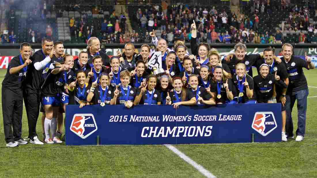 FC Kansas City pose with the trophy after the NWSL soccer championship match in Portland, Ore., on Oct. 1. Deford's commentary was corrected to include information about the NWSL, the top professional women's soccer league in the U.S.