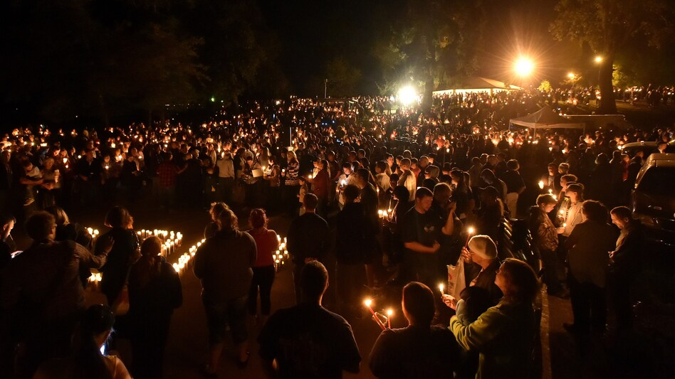 Hundreds of people gathered for a vigil in Roseburg, Ore., Thursday night, after 10 people died and seven others were wounded in a shooting at the local community college. (Josh Edelson/AFP/Getty Images)