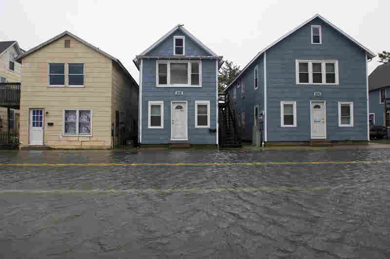 Houses are lined along flooded street in the downtown section of Ocean City, Md., on Saturday.