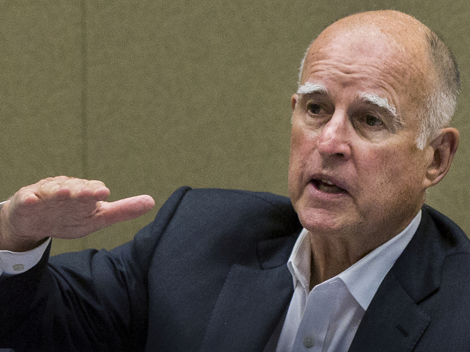 California Gov. Jerry Brown signed legislation Monday that makes it legal for doctors to help terminally ill patients who choose to die. (Damian Dovarganes/AP)