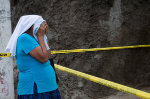 Marcela's grandmother cries at the scene of her granddaughter's death. (Encarni Pindado/for NPR)