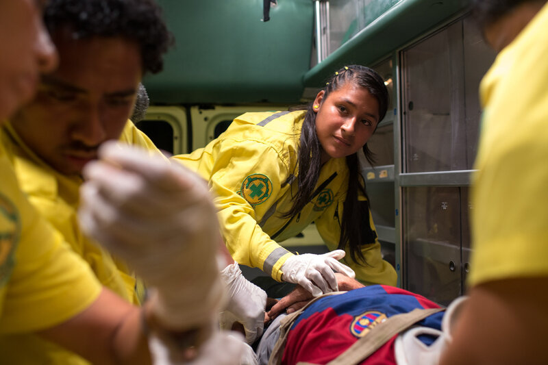 Mimi, 15, volunteers at Comandos de Salvamento. She deals with all kinds of emergencies, extreme violence and people that have been severely injured or killed by the gangs in El Salvador. (Encarni Pindado/for NPR)