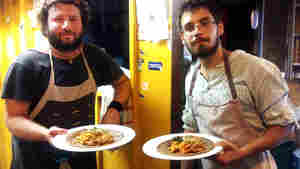 Andris Roder (left) and Adam Finding, cooks at the Kisuzem restaurant in Budapest, prepare a traditional Eritrean meal of injera bread, chickpea paste and meat stew. Their restaurant served up Eritrean food all week for a food festival in solidarity with migrants and refugees streaming into Hungary.