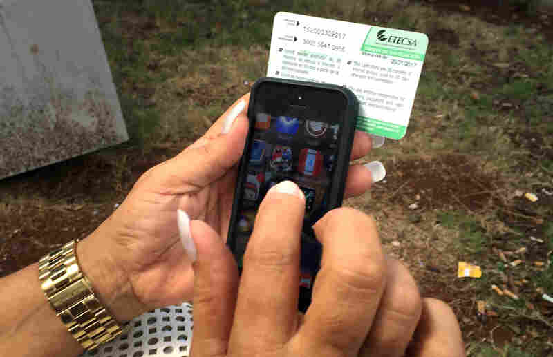 Mari Jimenez, 53, uses an Internet access card sold by the state phone company.