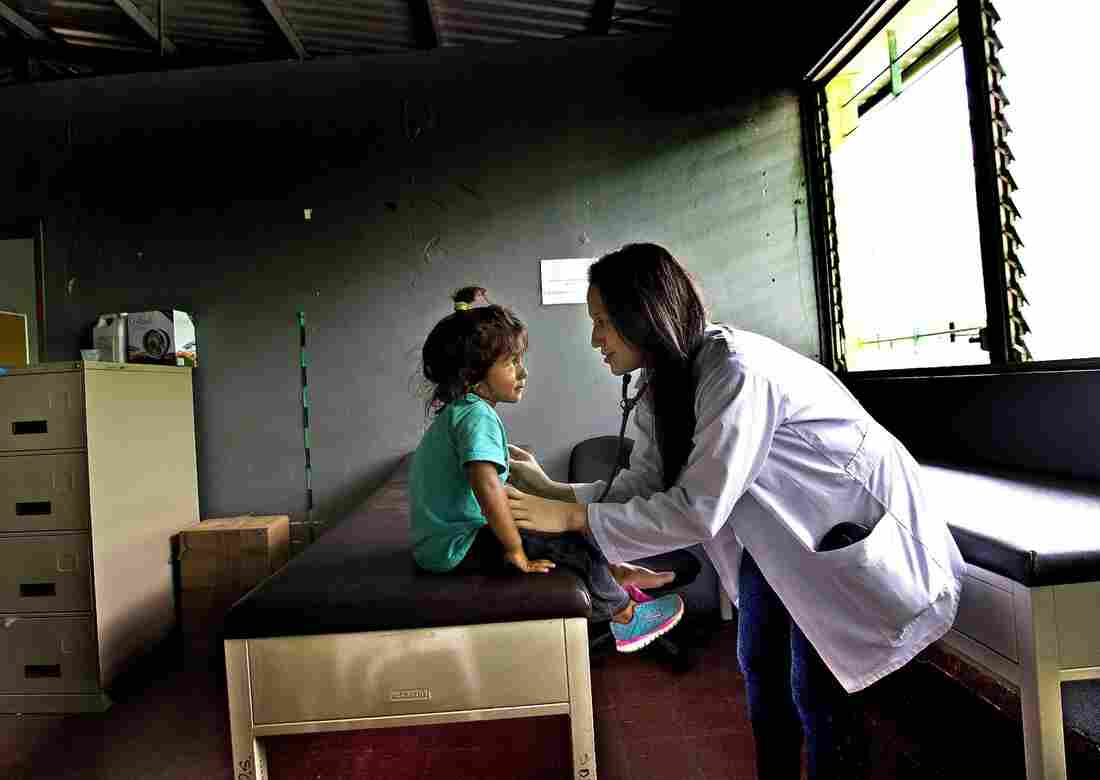 Dr. Mirna Hernández examines 3-year-old Maylin Maybel López at the El Edén center in San Pedro Sula, Honduras. Maylin and her family arrived at the center along with other migrants who were bused back to Honduras after being intercepted in Mexico on an attempt to reach the U.S.