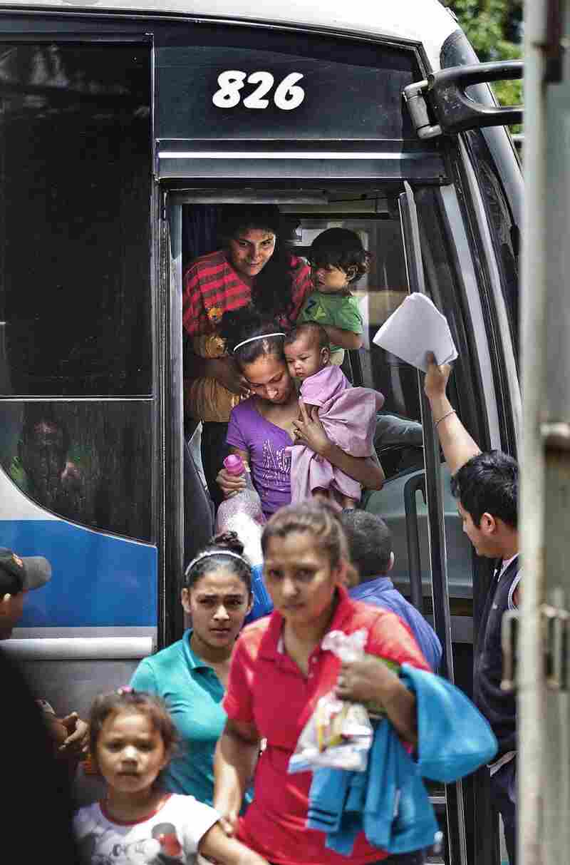 A bus carrying deportees arrives at El Edén center in San Pedro Sula, Honduras. The center receives Hondurans bused home after being intercepted in Mexico on their trek to the U.S. Mexico stepped up its deportation efforts after a wave of Central American migrants traveled through Mexico and reached the U.S. last year.