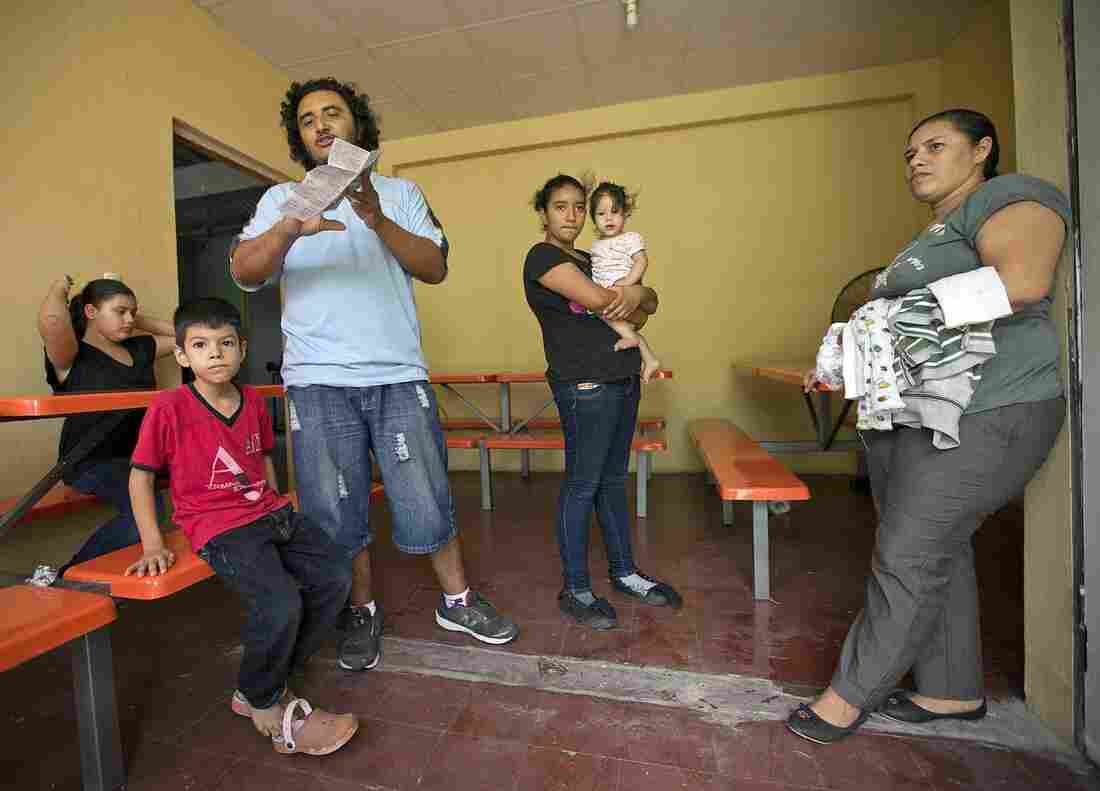 Menelio Briones, 32, along with his wife, Marinelis Sabillón, 33, and their five children arrive at the El Edén center in San Pedro Sula, Honduras. They were attempting to reach the U.S., but were picked up in Mexico and deported.