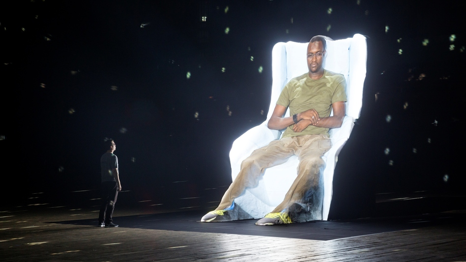 """The image of former Guantanamo detainee Mohammed El Gharani is projected onto what Laurie Anderson calls a """"film sculpture"""" in her multimedia work Habeas Corpus. (Park Avenue Armory)"""