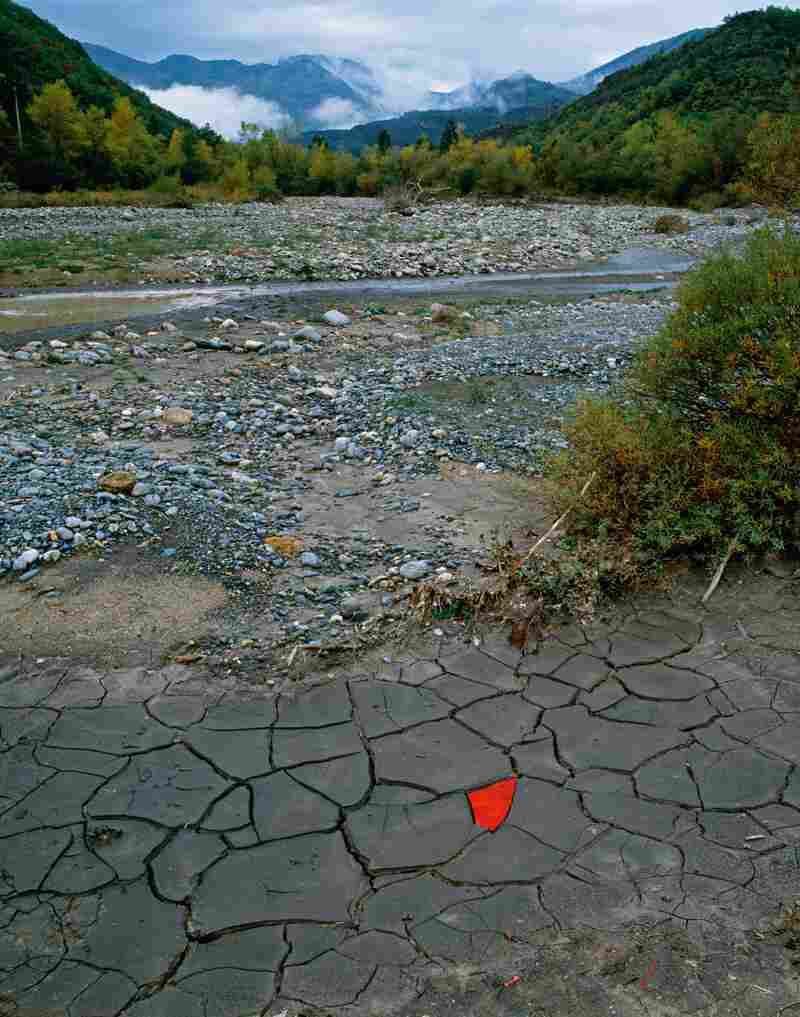 Red leaves cover a patch of cracked river clay in Digne-les-Bains, France. (Oct. 13, 2004)