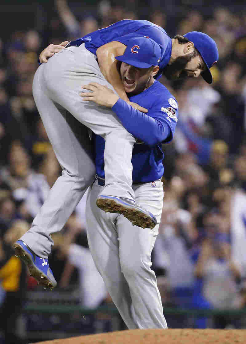 Chicago Cubs first baseman Anthony Rizzo hoists starting pitcher Jake Arrieta aloft after he finished a complete-game shutout of the Pittsburgh Pirates in the National League wild card game Wednesday in Pittsburgh. Arrieta struck out 11 while giving up four hits and no walks.