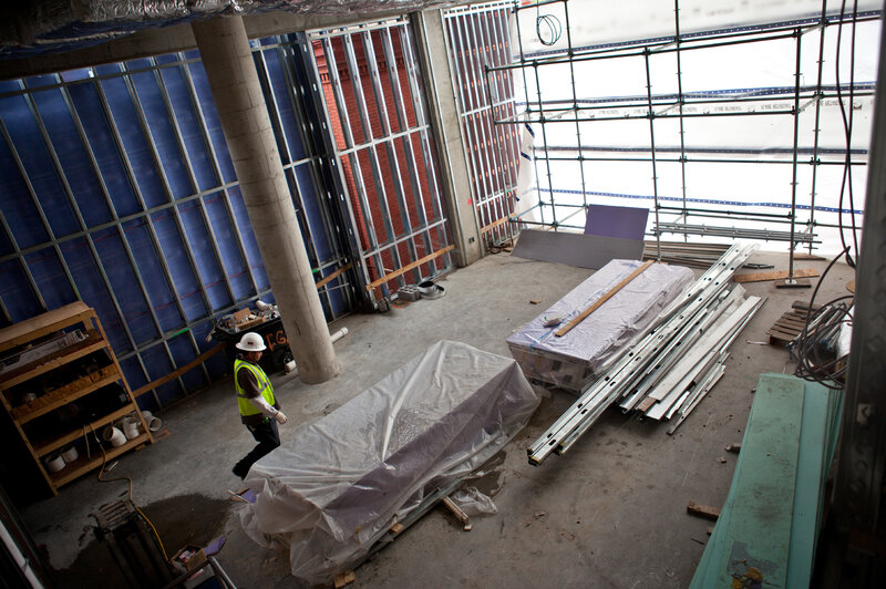 A view of construction underway, showing what will eventually be open community space at the John and Jil Ker Conway Residence. (Jun Tsuboike/NPR)