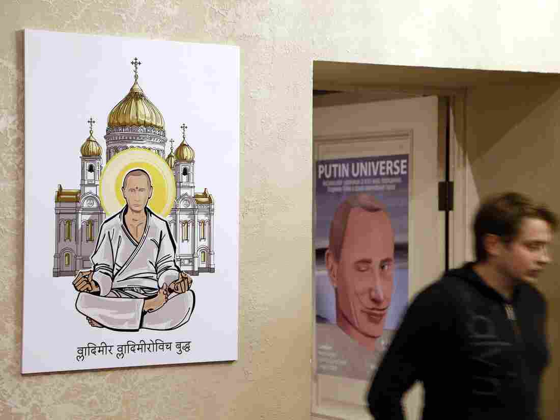 """The Russian leader, shown here as """"Vladimir Vladimirovich Buddha,"""" was depicted as various pop culture heroes and religious, mythical and historical figures at a Moscow exhibition on Wednesday, his 63rd birthday."""