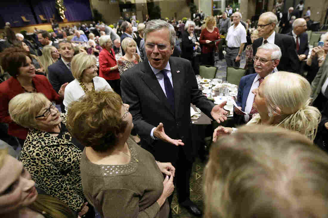 Republican presidential candidate and former Florida Gov. Jeb Bush talks to voters at the Scott County Republican Party's Ronald Reagan Dinner on Tuesday in Bettendorf, Iowa.