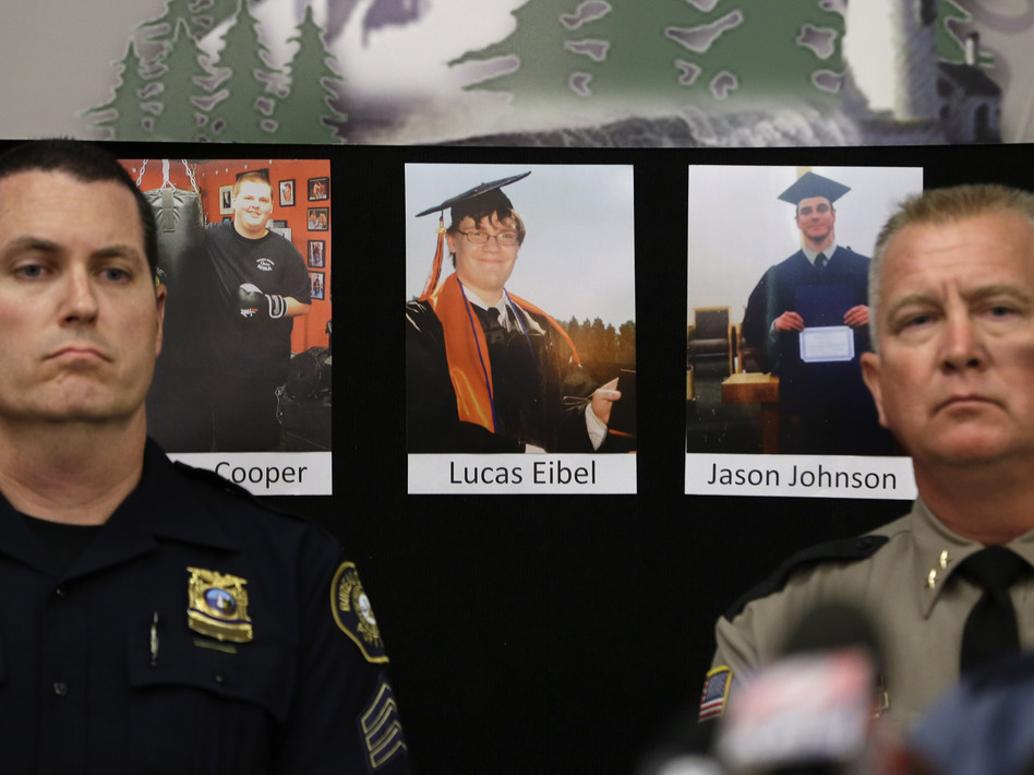 Photos of victims of the mass shooting at Umpqua Community College in Roseburg, Ore., are displayed behind Portland Police Sgt. Peter Simpson (left) and Douglas County Sheriff John Hanlin. (Rich Pedroncelli/AP)