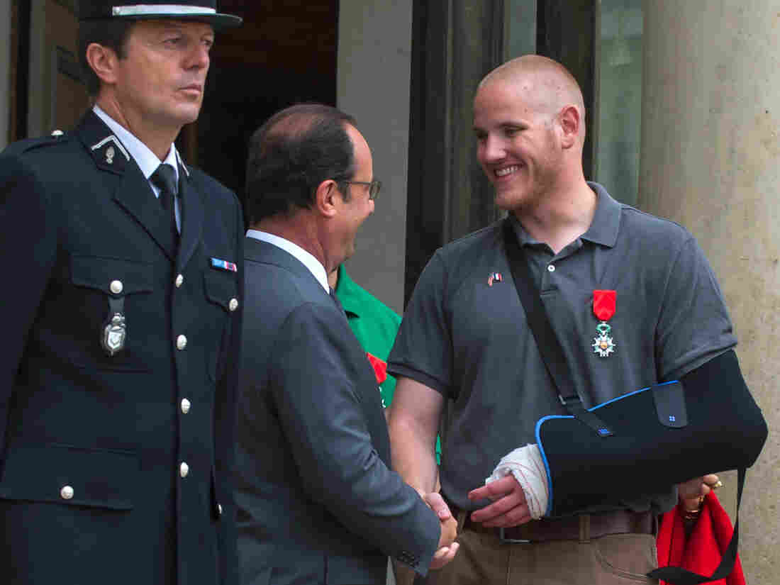 French President Francois Hollande shakes hands with U.S. Airman 1st Class Spencer Stone on Aug. 24 after Stone and two friends were awarded the French Legion of Honor for subduing a gunman on a Paris-bound train.