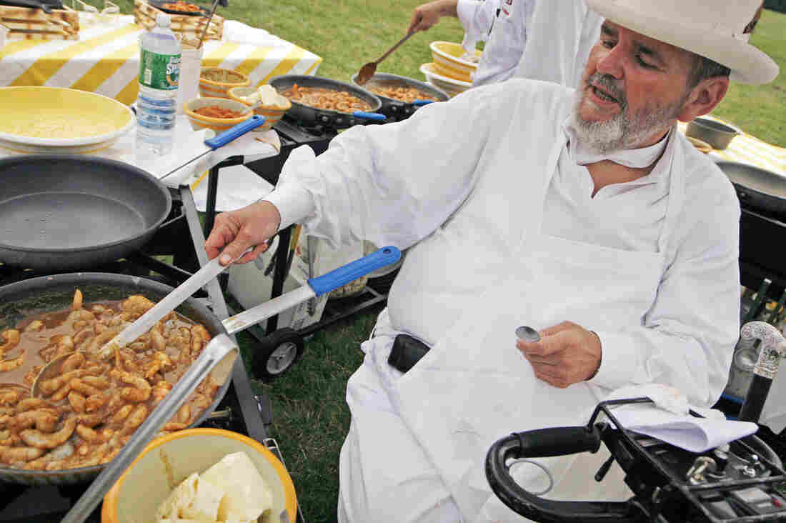 New Orleans Chef Paul Prudhomme prepares barbecue shrimp at the annual White House Congressional Picnic in 2007.