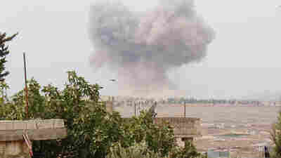 Smoke rises after airstrikes hit Syria's rebel-held Idlib Province. Archaeologist Abdul Rahman al-Yehiya says residents in his area of Idlib were running their own schools, government and courts. But the airstrikes have set them back. Rebels backed by the U.S. say Russia has been carrying out daily airstrikes in territory they control.