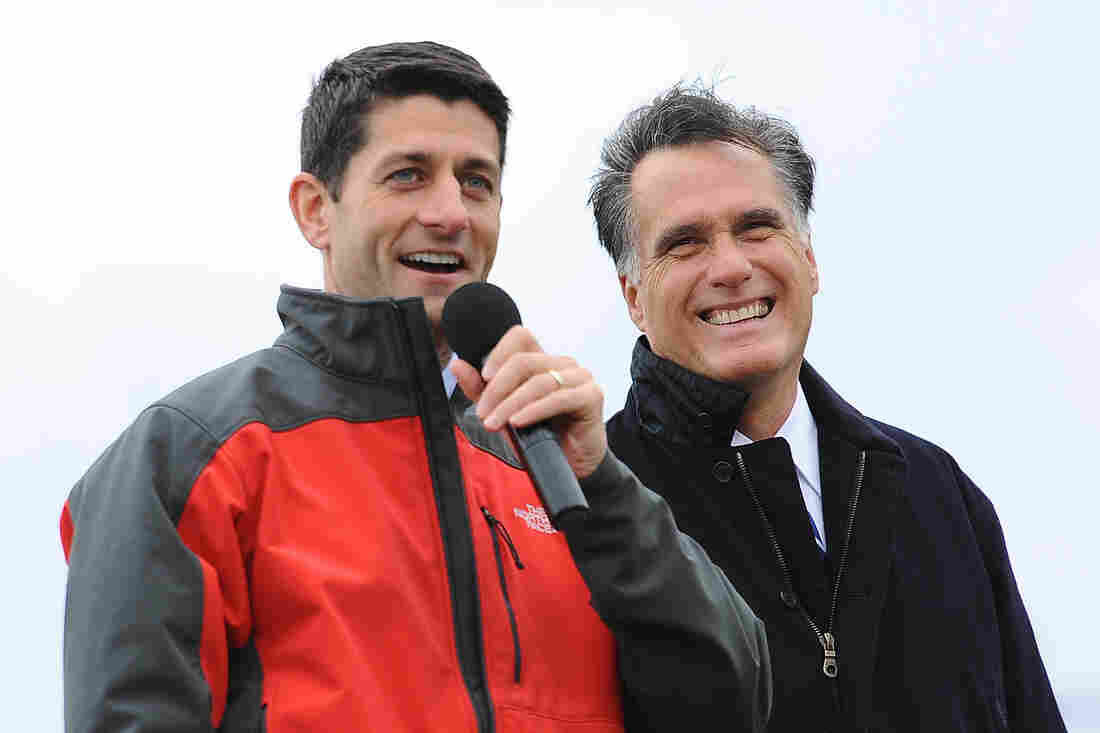 Then-vice presidential nominee Paul Ryan campaigns with his GOP running mate, former Massachusetts Gov. Mitt Romney, at a Celina, Ohio, rally in 2012. Friday, the two spoke by phone as Ryan faces pressure to run for speaker of the House.