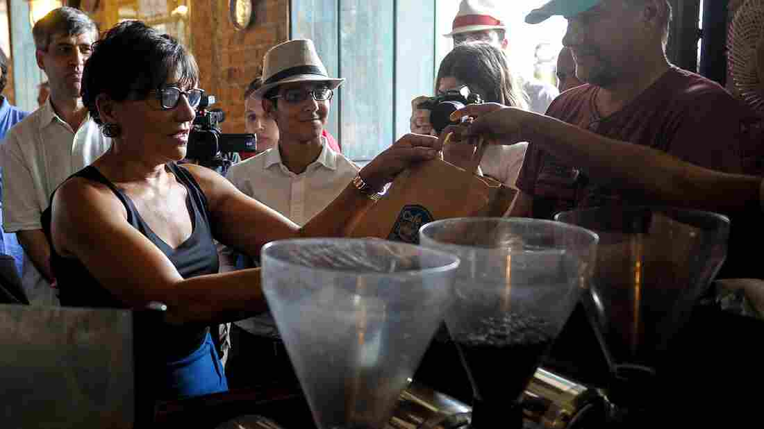 U.S. Secretary of Commerce Penny Pritzker buys coffee in Old Havana as part of a trade visit this week.