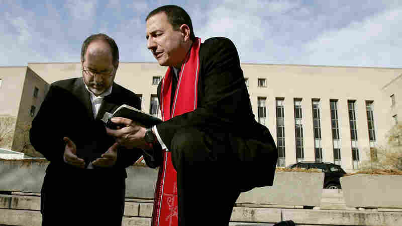 The Rev. Rob Schenck, of the National Clergy Council (right), and the Rev. Patrick Mahoney, director of the Christian Defense Coalition, pray in front of the J. Barrett Prettyman Federal Courthouse in Washington, D.C., in 2005. Schenck is a pro-life activist who believes gun ownership and the use of guns is a decision best decided by community leaders, not the government.