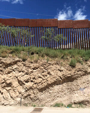 The fence between Nogales, Mexico, and Nogales, Ariz., sits atop a steep embankment. It's 20 to 25 feet high, with 3.5-inch gaps between the bars.