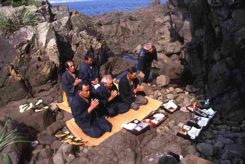 """""""Hidden Christians"""" perform a ritual to obtain holy water on Ikitsuki Island in southern Japan's Nagasaki prefecture, not far from where Spanish and Portuguese Catholic missionaries landed in the mid-1500s. After Catholicism was banned by Japan's military rulers, hidden Christians got rid of visible signs of Christianity, such as churches and crosses."""