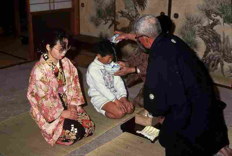 A baptism ceremony for a child on Ikitsuki Island, Nagasaki prefecture. After Japan's military ruler banned Christianity in the late 1500s, many Christians went underground, holding services such as these in their homes.
