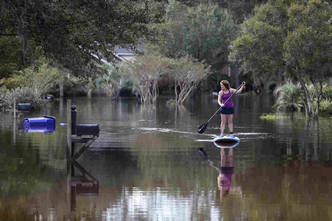 Tara Saracina rows down her street in the Ashborough subdivision of Summerville, S.C., on Thursday.