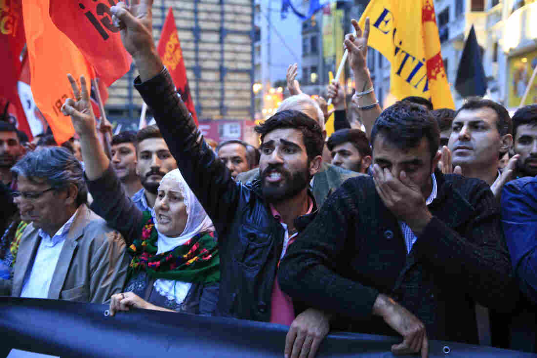 Demonstrators chant slogans and flash the V-sign during a rally to protest against the bombing in Ankara on Saturday.