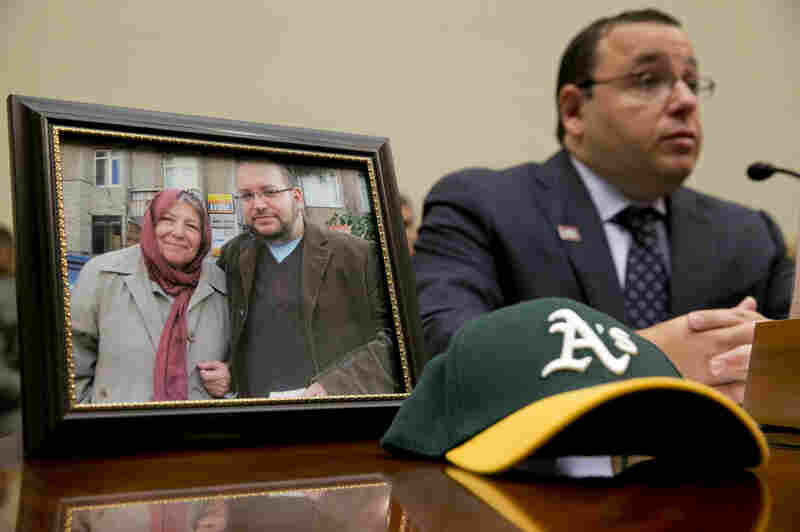 Ali Rezaian, brother of imprisoned Washington Post journalist Jason Rezaian, speaks by a picture of Jason and his mother on June 2. A verdict has been reached in Jason Rezaian's case, an Iranian official says, but it's not clear what the verdict is.