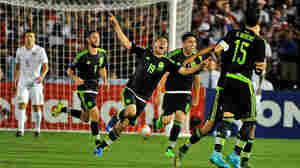 Mexico's Oribe Peralta (#19) celebrates after scoring against the United States during the CONCACAF playoff game, a 2017 Confederations Cup qualifier, at Rose Bowl on Saturday night, Oct. 10.