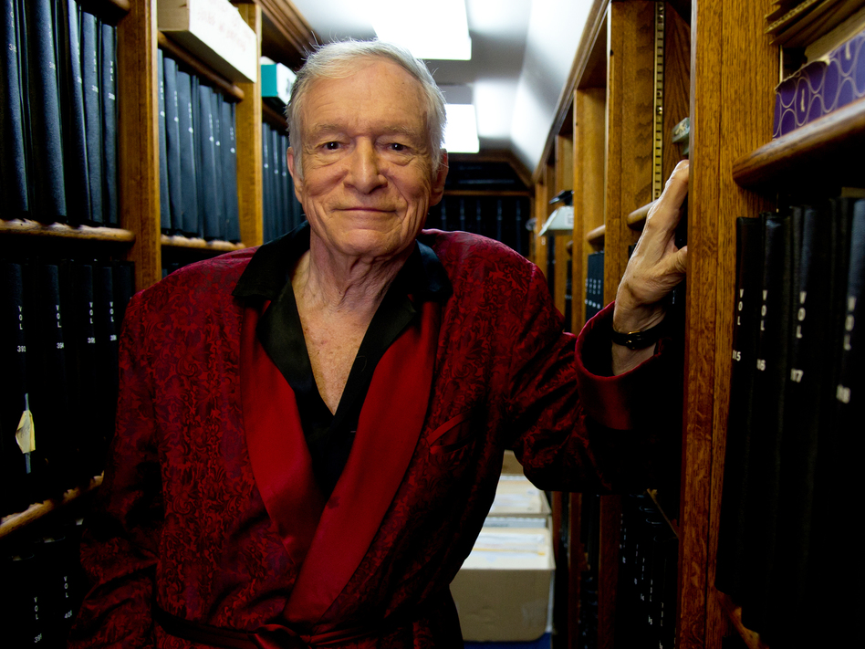 <em>Playboy</em> founder Hugh Hefner poses for a photograph at his home in Beverly Hills in 2011. (Kristian Dowling/AP)