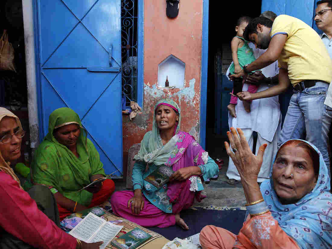 Relatives mourn Mohammad Ikhlaq Saifi in his village outside New Delhi last month. The Muslim man was lynched, allegedly by a Hindu mob, after he was accused of killing a cow.