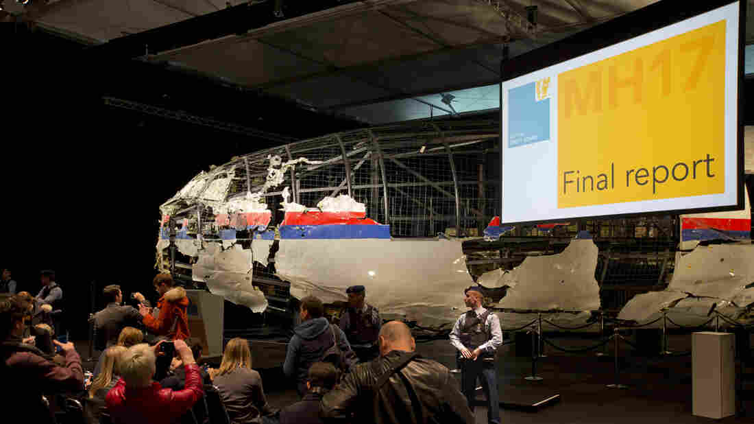 Part of the reconstructed Malaysia Airlines Flight 17 plane is seen prior to the presentation of the Dutch Safety Board final report on what caused the Boeing 777 to break up high over eastern Ukraine last year.