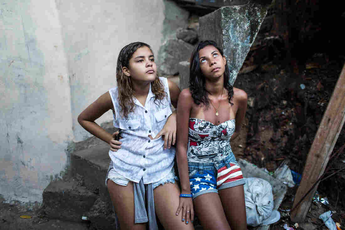 "Soccer buddies Lahis Maria Ramos Veras, 14 (left), and Milena Medeiros dos Santos, 16, don't let taunts keep them from playing. Lahis goes by the nickname ""Lala."""