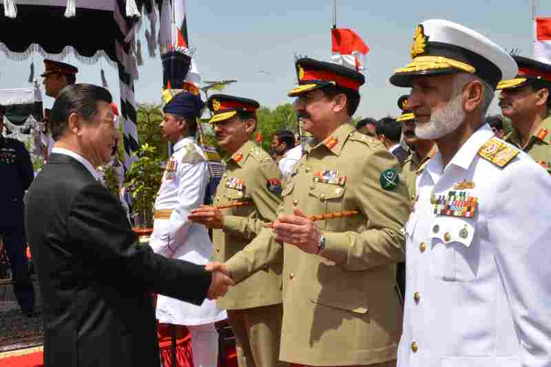 China's President Xi Jinping (left) greets Pakistan's army chief Gen. Raheel Sharif in Islamabad, Pakistan, on April 20. During Xi's visit, the two sides launched an ambitious $46 billion economic corridor linking Pakistan's port of Gwadar with western China.