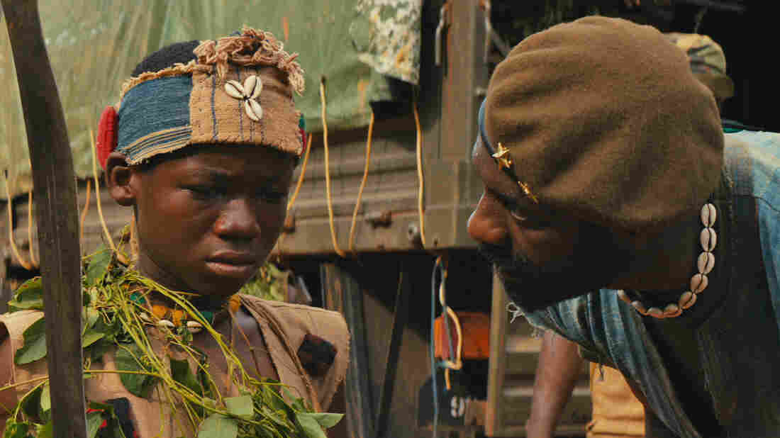 Idris Elba and Abraham Attah in the Netflix original film Beasts of No Nation.