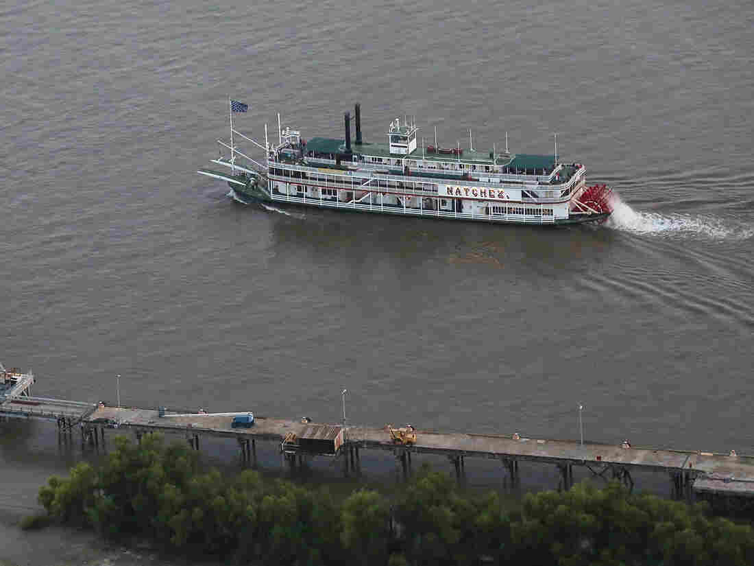 """A steamboat drifts along the Mississippi River in New Orleans. A group called America's Watershed Initiative says """"funding for infrastructure maintenance means that multiple failures may be imminent"""" for the lower Mississippi River basin."""