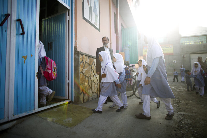 This is something you never would have seen under the Taliban: Girls walking to school. (David Gilkey/NPR)