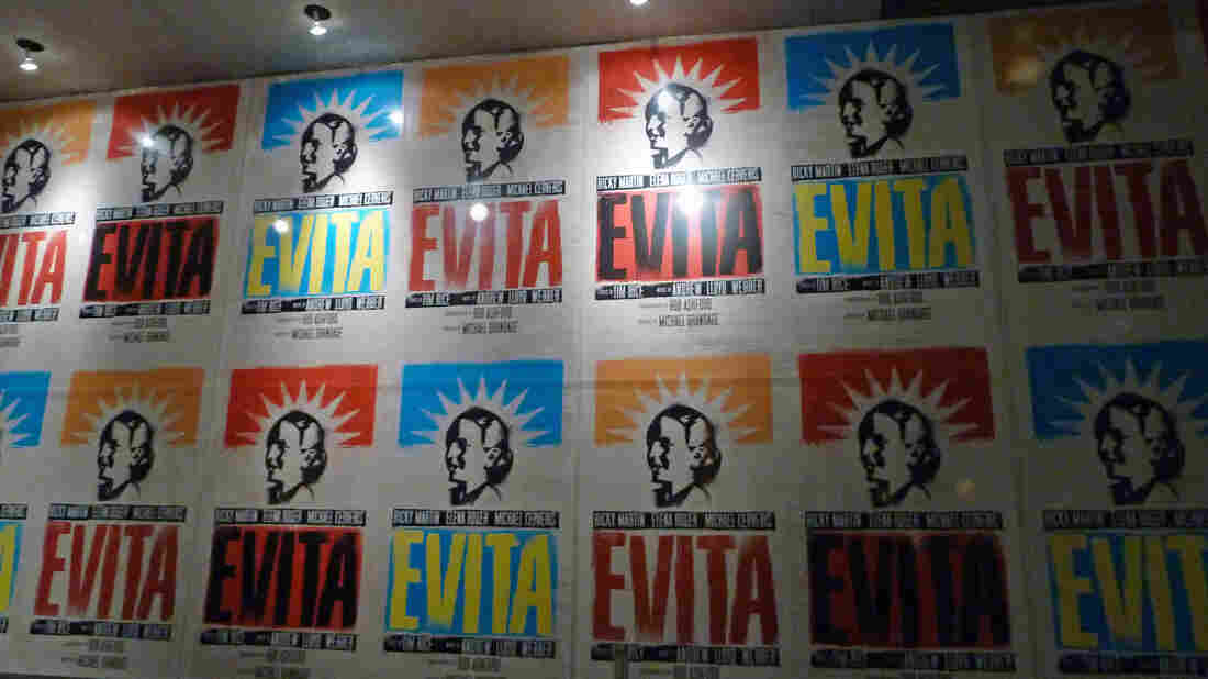 """Movie posters for the 2012 revival of the musical """"Evita"""" are displayed outside the Marquis Theater in New York City."""