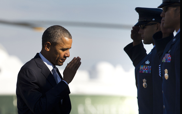 President Obama salutes prior to boarding Air Force One last Friday. The president entered office saying he would end the U.S. role in the Iraq and Afghan wars. But U.S. forces were sent back to Iraq last year and he announced Thursday that 5,500 American troops would remain in Afghanistan beyond their previously planned departure at the end of 2016.