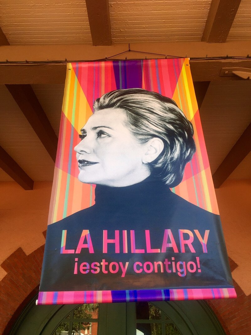 "A new Clinton campaign poster unveiled at an event in San Antonio says ""I'm with you"" in Spanish."