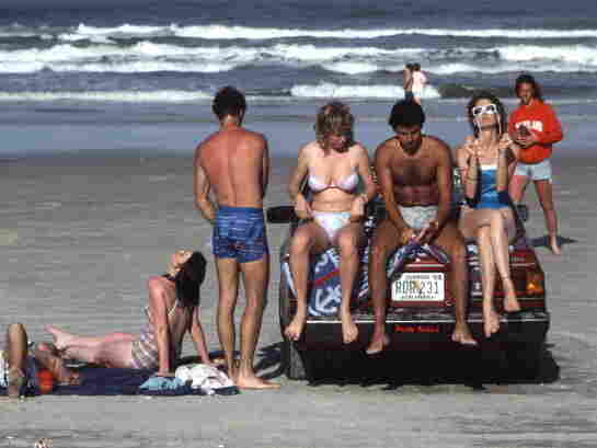 College students and other teenagers enjoy the sun in 1986, when cars were an undisputed part of this spring break destination and more than 47 miles of Volusia County beaches were open to vehicles.