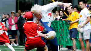 A combination photo shows London's Mayor Boris Johnson colliding with 10-year-old Toki Sekiguchi during a game of Street Rugby.