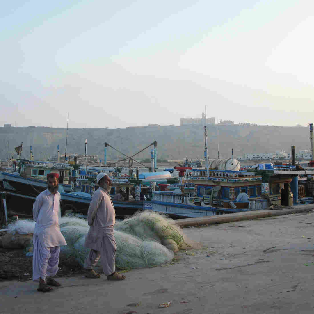 Two men stand near the port in Gwadar, Pakistan. NPR's Phil Reeves unexpectedly ended up a VIP there — and it wasn't a good feeling.