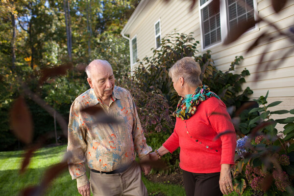 Alan Hoffman, shown with his wife Nancy at their home in Dumfries, Va., found that his Parkinson's symptom improved when he took a cancer drug.
